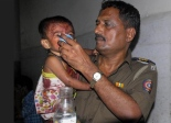 Mumbai policeman feeding child injured in terror attack