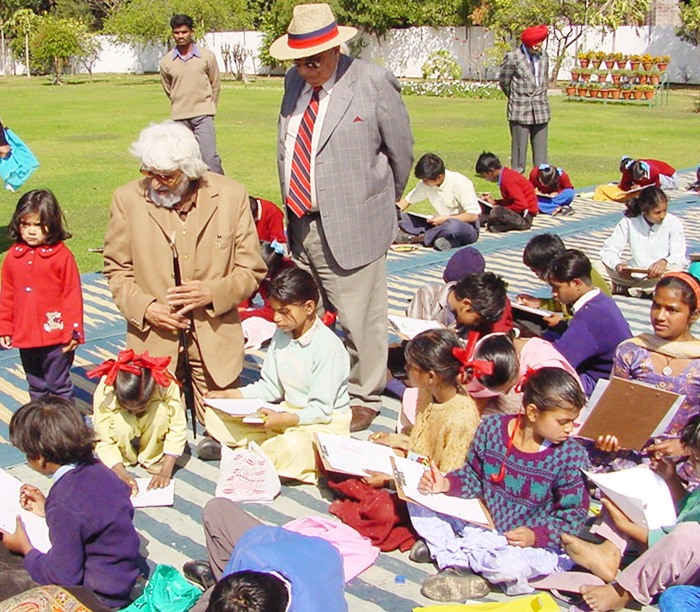 M F Hussain giving tips to children