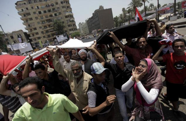 Demonstrators chant slogans at Tahrir Square in Cairo