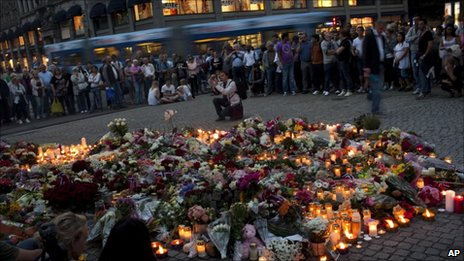 Mourners have been gathering in the centre of Oslo