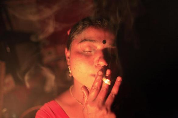 Seventeen-year-old Hashi smokes a cigarette