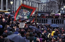 A banner representing National Union of Mineworkers is carried through crowd at party to celebrate death of late former British PM Thatcher in central London