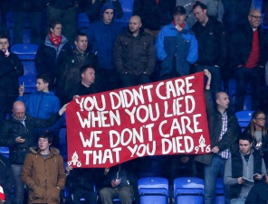 Liverpool fans hold up a banner commenting on the death of former British PM Thatcher, before their English Premier League soccer match against Reading, in Reading