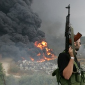 A Lebanese Hezbollah guerrilla -Reuters