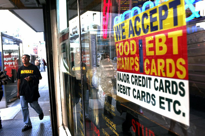 NEW YORK - OCTOBER 07: A sign in a market window advertises the acceptance of food stamps on October 7, 2010 in New York City. New York Mayor Michael Bloomberg is proposing an initiative that would prohibit New York City's 1.7 million food stamp recipients from using the stamps, a subsidy for poor residents, to buy soda or other sugary drinks. Bloomberg has stressed that obesity among the poor has reached critical levels.   Spencer Platt/Getty Images/AFP