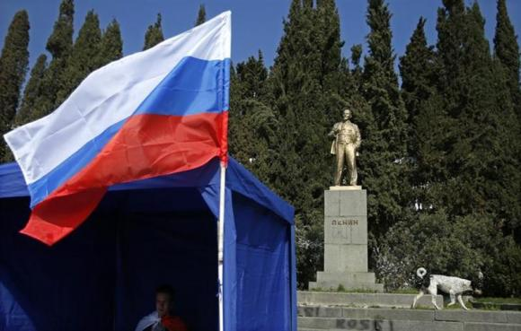 A pro-Russian activist sits inside a tent in front of Lenin's statue in Alupka (Crimea) March 12, 2014.