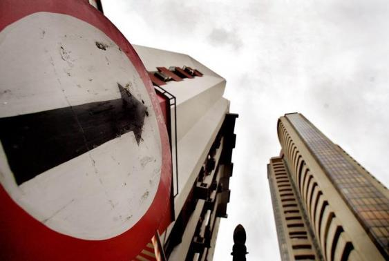 A road sign stands next to the Bombay Stock Exchange building