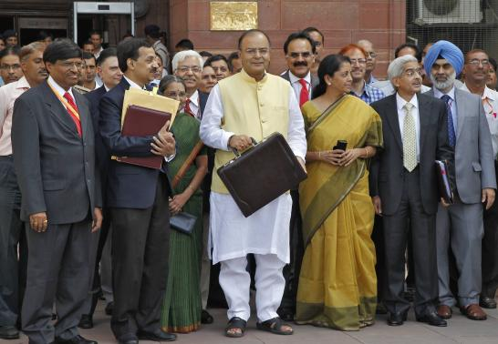 Finance Minister Arun Jaitley (Centere) with Nirmala Sitaraman
