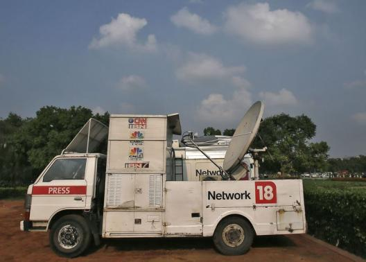 A van of media group Network18 is parked outside the Indian parliament in New Delhi