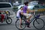13 A girl on bicycle in Beijing