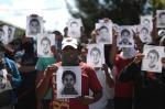 01 Protestors sho missing students' photos -Guerrero