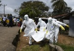09 Ebola victim carried by Red Cross staff