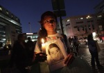 13 Protester with missed student's photo in Moterrey -Oct 8
