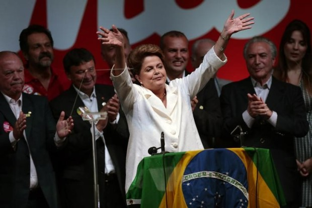 Brazil's President and Workers' Party presidential candidate Rousseff celebrates after the disclosure of election results, in Brasilia