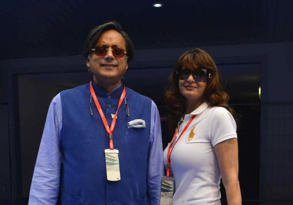 Sunanda poses with her husband at the Indian F1 Grand Prix  in Greater Noida