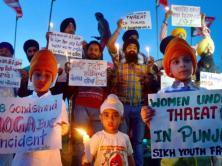 Candle light vigil aganist Moga molestation