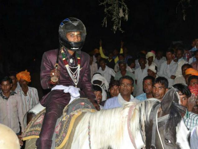 Dalit groom Pavan Malaviya with helmet protection!