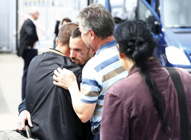 Relatives welcome Swiss survivors of Saturday's earthquake in Nepal after their arrival at Bern airport