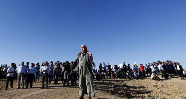 Kurdish people in Kobani watching ISIS attack