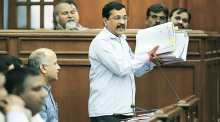 Kejriwal showing documents in Delhi Assembly
